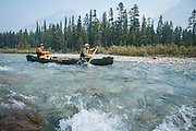 Alan and Aaron Schmidt canoe on the Bow River, Banff, Alberta.