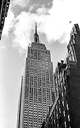 This original black and white image of New York City's Empire State Building was taken in November 2004 by Matthew James Harrison. The image was captured on a manual SLR Olympus OM-1 using film and then scanned in to a digital archive in 2009. No filters have been used.