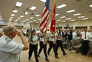 Veteran's salute the color guard from East Bay High School Junior ROTC during a Veteran's Day ceremony in Sun City Center, Florida.