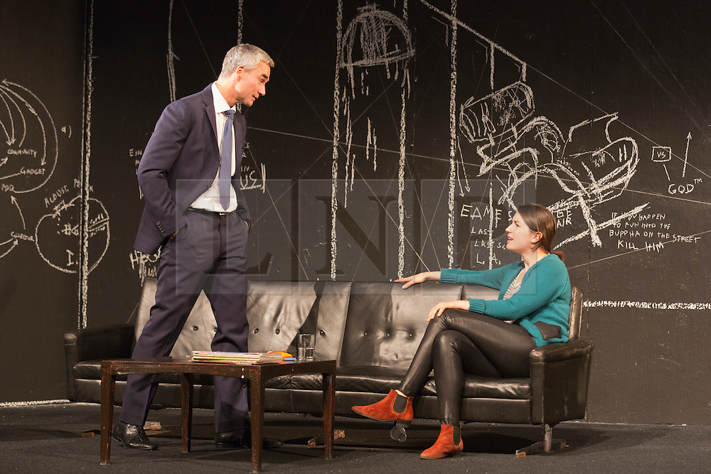 """© Licensed to London News Pictures. 24/09/2014. London, England. Pictured: Ingo Hülsmann as Member of the City Council and Eva Meckbach as Mrs Stockmann. German theatre company Schaubühne Berlin present an adaptation of """"An Enemy of the People"""" by Henrik Ibsen at the Barbican Theatre, Barbican Centre, from 24-28 September 2014. The play is directed by Thomas Ostermeier and part of the International Ibsen Season. Photo credit: Bettina Strenske/LNP"""
