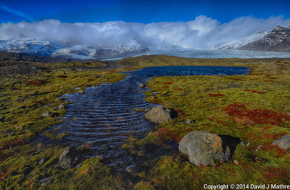 Pond and Mossy Field Below the Hvannadalshnjukur Glacier in Southeastern Iceland. HDR Composite of three images taken with a Fuji X-T1 camera and Zeiss 12 mm f/2.8 lens (ISO 200, 12 mm, f/16)