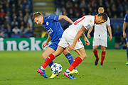 Leicester City Midfielder Marc Albrighton and Sevilla midfielder Vitolo (20) during the Champions League round of 16, game 2 match between Leicester City and Sevilla at the King Power Stadium, Leicester, England on 14 March 2017. Photo by Richard Holmes.