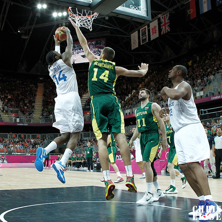 02 August 2012: France Ronny Turiaf grabs a rebound during 82-74 Team France victory over Team Lithuania, during the men's basketball preliminary, at the Basketball Arena, in London, Great Britain.