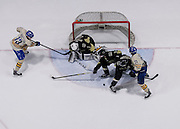 21 February 2015: UBC defensman Ben Schmidt (13) shoots on Manitoba goalie Byron Spriggs (1) as  forward Joel Schreyer (23) battles with Manitoba forward Jesse Paradis (16) and Channing Bresciani (2) during a CIS Men's Hockey - Canada West Quarter-Final Playoffs.  Game #3 (best of 3) between the University of British Columbia Thunderbirds and the University of Manitoba Bisons at Mitchell Arena, University of British Columbia, Vancouver, BC, Canada.    ****(Photo by Bob Frid/UBC Athletics) 2015 All Rights Reserved****
