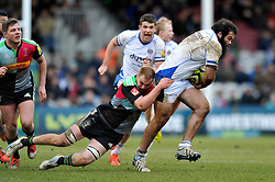 Kane Palma-Newport of Bath Rugby is tackled by Harry Sloan of Harlequins - Photo mandatory by-line: Patrick Khachfe/JMP - Mobile: 07966 386802 31/01/2015 - SPORT - RUGBY UNION - London - The Twickenham Stoop - Harlequins v Bath Rugby - LV= Cup