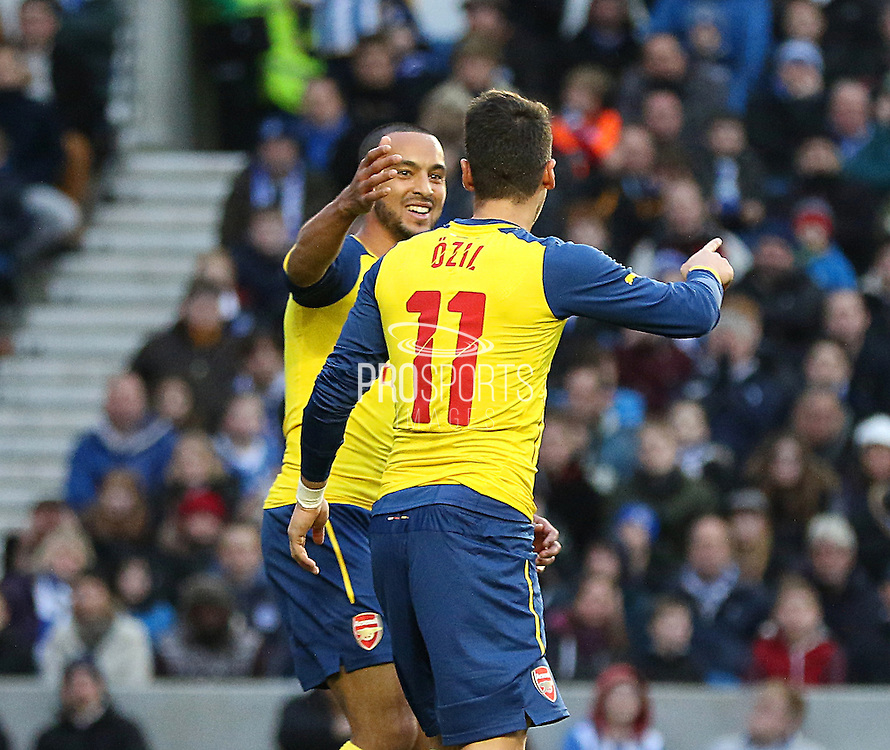 Arsenal's Theo Walcott congratulates Arsenal's Mesut Özil  during the The FA Cup match between Brighton and Hove Albion and Arsenal at the American Express Community Stadium, Brighton and Hove, England on 25 January 2015. Photo by Phil Duncan.
