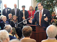 """Chris Serpico, a former board chairperson for the Central Bucks YMCA, leads participants in the singing of """"Happy Birthday"""" during the organization's 50th Anniversary kickoff event Thursday January 28, 2016 in Doylestown, Pennsylvania. (Photo by William Thomas Cain)"""