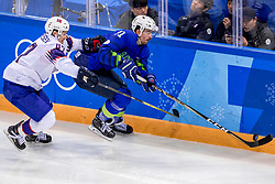 GANGNEUNG, SOUTH KOREA - FEBRUARY 20: Forward Miha Verlic #91 of Slovenia, forward Kristian Forsberg #26 of Norway in action during Ice - Hockey match between National Teams of Slovenia and Norway in the Men's Play-offs Qualifications on day eleven of the PyeongChang 2018 Winter Olympic Games at Gangneung Hockey Centre on February 20, 2018 in Gangneung, South Korea.  Photo by Ronald Hoogendoorn / Sportida