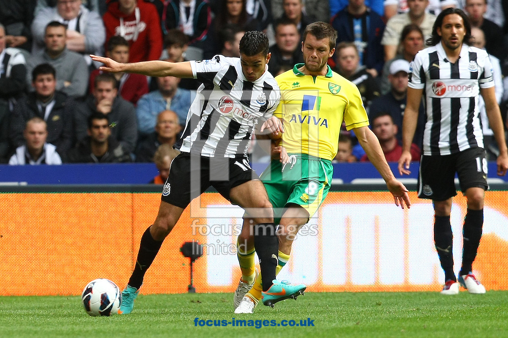 Picture by Paul Chesterton/Focus Images Ltd +44 7904 640267.23/09/2012.Jonny Howson of Norwich and Hatem Ben Arfa of Newcastle in action during the Barclays Premier League match at the Sports Direct Arena, Newcastle.