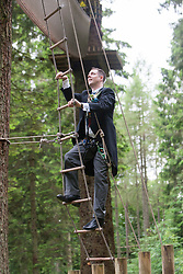 Martin Milner and Colette Gregory tying the knot in the trees at Go Ape Aberfoyle. Martin heading up to walk to the platform for the wedding vows.
