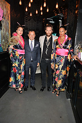 Left to right, SENG KHOU and MARC BURTON with Geisha Girls at the launch of Geisha at Ramusake hosted by Piers Adam and Marc Burton at Ramusake, 92B Old Brompton Road, London on 11th June 2015.