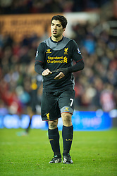 STOKE-ON-TRENT, ENGLAND - Boxing Day Wednesday, December 26, 2012: Liverpool's Luis Alberto Suarez Diaz walks off dejected after losing 3-1 to Stoke City during the Premiership match at the Britannia Stadium. (Pic by David Rawcliffe/Propaganda)