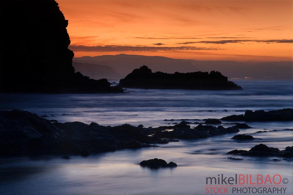 Coast rocks at sunset. Atxabiribil beach. Sopelana, Biscay, Basque Country, Spain, Europe.