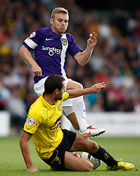 Oxford United's Alfie Potter is tackled by Burton Albion's Phil Edwards  - Photo mandatory by-line: Matt Bunn/JMP - Tel: Mobile: 07966 386802 07/09/2013 - SPORT - FOOTBALL -  Pirelli Stadium - Burton upon Trent - Burton Albion V Oxford United - Sky Bet League Two