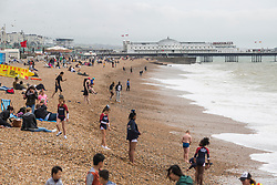 © Licensed to London News Pictures. 11/06/2017. Brighton, UK. Members of the public brave the strong  gusts of wind and powerful waves to spend some time on the beach in Brighton and Hove. Photo credit: Hugo Michiels/LNP