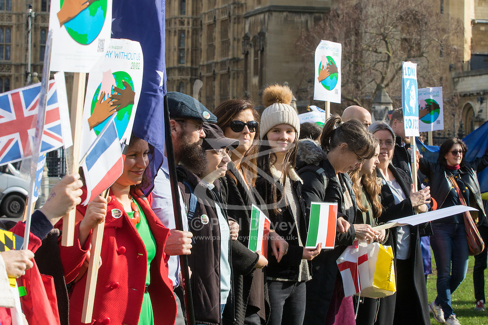 Parliament Square, London, February 20th 2017. A 'Flag Mob' protest by immigrant workers is held in Parliament Square as part of the One Day Without Us action by immigrant workers to highlight and celebrate their contribution to the UK economy, said to be worth £328 million per day. The flags represent the foreign workers' diverse countries of birth.