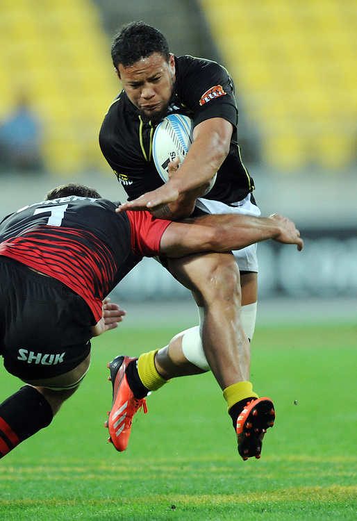 Wellingtons' Alapati Leiua breaks the tackle of Canterburys' George Whitelock in the ITM Cup Rugby Premiership Final at Westpac Stadium, Wellington, New Zealand, Saturday, October 26, 2013. Credit:SNPA / Ross Setford