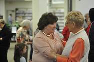 Dotsy Fitts (left), who served as head librarian for 44.5 years at the Lafayette County and Oxford Public Library, visits with Virginia Chrestman at a retirement party in her honor in Oxford, Miss. on Thursday, November 8, 2012.