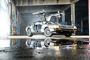 Glen Rock, Pennsylvania - April 03, 2018: A 1980's inspired retro-futuristic scene featuring a Delorean and a documentary photographer of the future. <br /> <br /> Concept shoot made for the ASMP Baltimore Chapter's Future Biz workshop. <br /> <br /> CREDIT: Matt Roth