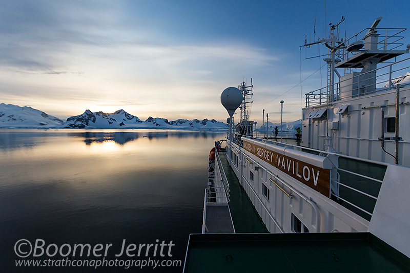 The sun sets on another day of exploring the Antarctic Peninsula aboard Akademik Vavilov.  Antarctica.