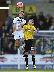 Hereford United's Frankie Artus wins an aerial duel with Burton Albion's Matthew Palmer - Photo mandatory by-line: Matt Bunn/JMP - Tel: Mobile: 07966 386802 10/11/2013 - SPORT - FOOTBALL - Pirelli Stadium - Burton upon Trent - Burton Albion v Hereford United - FA Cup