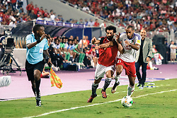 October 8, 2017 - Alexandria, Egypt - Egypt's Mohamed Salah vies for the ball against Congo's Tobias Badila during their World Cup 2018 Africa qualifying match between Egypt and Congo at the Borg el-Arab stadium in Alexandria on October 8, 2017. (Credit Image: © Islam Safwat/NurPhoto via ZUMA Press)
