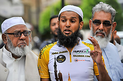 © Licensed to London News Pictures. 14/07/2017. London, UK. A Hajj cyclist gives a speech as Muslim cyclists gather at the East London Mosque in Whitechapel to set out on the 'Hajj Ride', the first ever charity cycle ride from London to Medina in Saudi Arabia.  The 3,500km, 6 week ride will pass through 8 countries raising funds for medical aid in Syria.  Intended to champion cycling in Muslim society, the ride also aims to satisfy one of the five pillars of Islam, being the Hajj pilgrimage to Mecca.  Photo credit : Stephen Chung/LNP