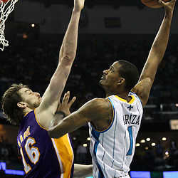 April 24, 2011; New Orleans, LA, USA; New Orleans Hornets small forward Trevor Ariza (1) is called for a offensive foul against Los Angeles Lakers power forward Pau Gasol (16) during the fourth quarter in game four of the first round of the 2011 NBA playoffs at the New Orleans Arena. The Hornets defeated the Lakers 93-88.   Mandatory Credit: Derick E. Hingle