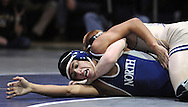 NEWTOWN, PA. - JANUARY 21: Council Rock North's Giancarlo Flores tries to maneuver out from under  Council Rock South's Robbie Fasciocco during the 126 lb wrestling match at Council Rock North High School January 21, 2015 in Newtown, Pennsylvania.(Photo by William Thomas Cain/Cain Images)  South aco