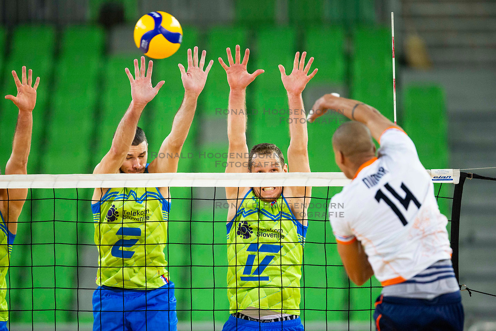 30-12-2019 SLO: Slovenia - Netherlands, Ljubljana<br /> Nimir AbdelAziz of the Netherlands and Alen Pajenk, Tine Urnaut of Slovenia during friendly volleyball match between National Men teams of Slovenia and Netherlands