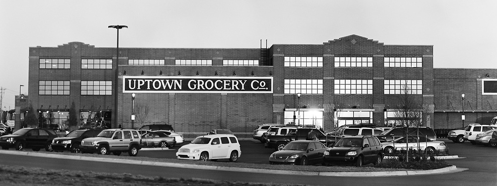 Black and white photograph on 4x5 Ilford HP5 film of Uptown Grocery Store in Edmond, OK