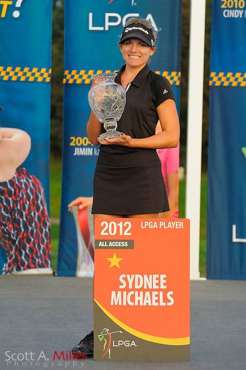 Sydnee Michaels with her LPGA card and winners trophy following the LPGA Future Tour's Price Chopper Tour Championship at Capital Hills at Albany on Sept. 11, 2011 in Albany, N.Y...©2011 Scott A. Miller