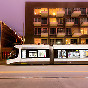 Kansas City Streetcar passing 1914 Main - new residential construction in downtown KCMO.