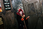 An actress is inviting the visitors to begin the tour inside the London Dungeon, England, on Thursday, Oct. 12, 2006. The London Dungeon is a live theatre attraction where visitors are taken by the actors through different areas featuring the darkest parts of British history. Some of the more than 40 exhibits include 'The Great Fire of London', 'Jack the Ripper', 'Judgement Day', 'The Torture Chamber', 'Henry VIII', 'The Tower of London' and 'The French Revolution'. In 2003 a new part opened focused on the Great Plague of 1665.   **Italy Out**..