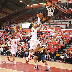 Rutgers Scarlet Knights guard Khadijah Rushdan (1) lays in a basket over West Virginia Mountaineers guard Vanessa House (12) during second half Big East NCAA women's basketball action during Rutgers' 67-58 victory over West Virginia at the Louis Brown Rutgers Athletic Center.