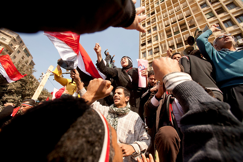 Cairo, Egypt - February 11th, 2011 - Egyptians demonstrate in Tahrir Square in downtown Cairo, in a concerted effort to draw attention to past police brutality, poverty and the rising cost of living; in spite of some deaths and many injured caused by police heavyhandedness.  Slogans were shouted against the president of Egypt, Hosny Mubarak; urging his government to step down after being in power for 30 years. Soon after this event, President Mubarak relinquished his presidency to the control of the Egyptian army. Photo by Wally Nell