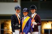Prijsuitreiking Klasse M2 1. Kim Noordijk - D'Joep, 2. Saskia van Es - Jaccardo, 3. Hilde Smits - Geneva<br /> KNHS Indoorkampioenschappen 2020<br /> © DigiShots