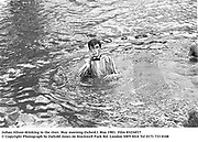 Julian Alison drinking in the river. May morning Oxford.1 May 1983. Party partly organised by Ding Boston, Film 83234f17<br />