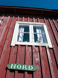 Detail of name plate on traditional red wooden building in village of Smogen on Swedens Bohuslan coast