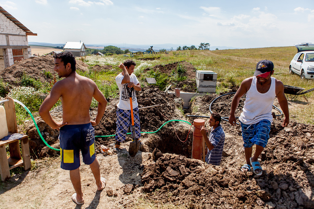 Emil (left), Michal (right), Rudo (2nd right) and a relative are  working on a new well for their own water supply close to their houses. In Rankovce, the only public source of drinking water for the village population was a well 400<br /> meters away, which was used on a daily basis by about three hundred people and which was often in the summer already empty in the morning.