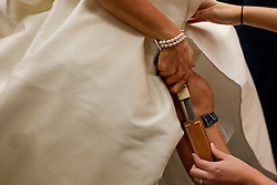 Margaret Briggs places a Highland Dagger under her dress before her wedding in Denver, Saturday, Sept. 8, 2012. Photo by Justin Edmonds