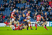 Jaco van der Walt (#10) of Edinburgh Rugby looks to offload as he is tackled by Adrian Motoc (#5) of SU Agen Rugby during the European Rugby Challenge Cup match between Edinburgh Rugby and SU Agen at BT Murrayfield, Edinburgh, Scotland on 18 January 2020.