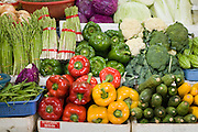 09 MARCH 2006 - HO CHI MINH CITY, VIETNAM: A vegetable stand with bell peppers, broccoli, cauliflower, asparagus and cucumbers. Many people in developing countries, like Vietnam, shop everyday for fresh food because many families don't have the large refrigerators families in the US do.  PHOTO BY JACK KURTZ