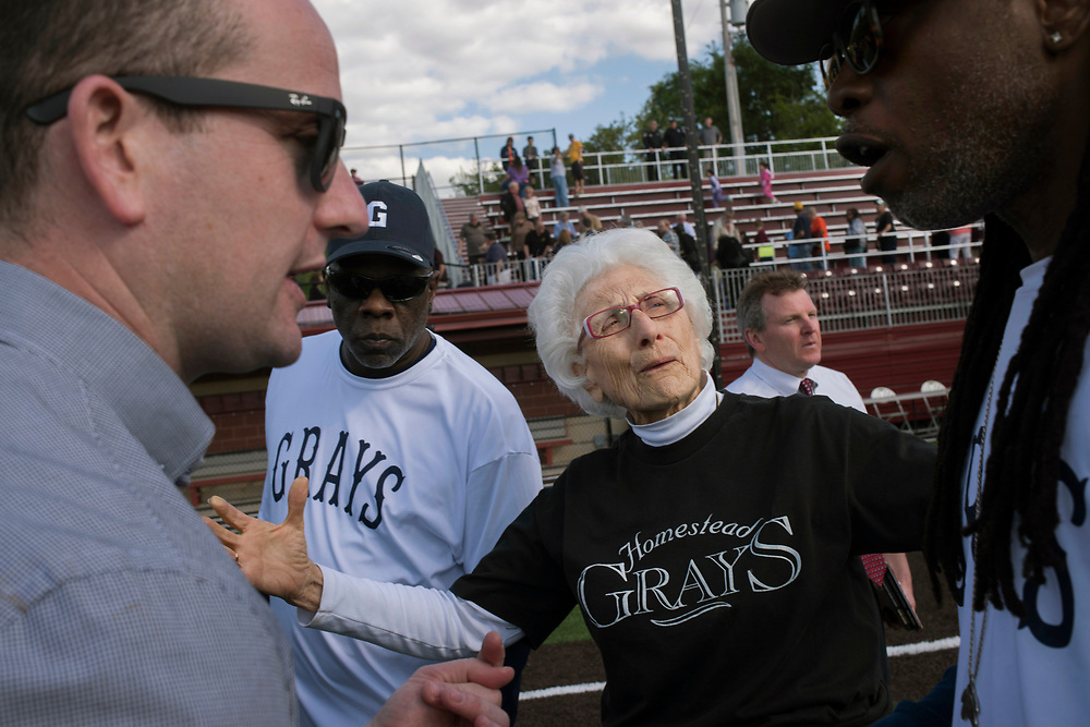 Homestead Mayor Betty Esper introduces Bill Campbell's son Jim Campbell (left) to a couple members of Homestead Grays Softball Team following the re-dedication of William W. Knight Memorial Field in Munhall. Tech executive and Homestead native Bill Campbell died the month before and his foundation funded the park's restoration. The ceremony was dedicated in his honor. The field was once home to the Negro League's Homestead Grays.  May 2016