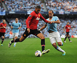 Manchester City's Pablo Zabaleta challenges Manchester United's Chris Smalling - Photo mandatory by-line: Dougie Allward/JMP - Tel: Mobile: 07966 386802 22/09/2013 - SPORT - FOOTBALL - City of Manchester Stadium - Manchester - Manchester City V Manchester United - Barclays Premier League