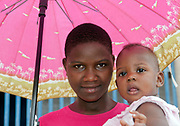 Mother and child and an umbrella in Mubende, Uganda.