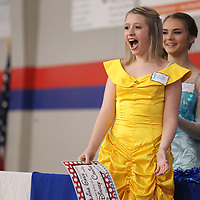 Alaina Gass, 14, reacts as she discovers her wish of a Disney Cruise has been granted Wednesday at Tupelo Christian Prepatory School in Tupelo. The school helped the Make-A-Wish foundation present two wishes Wednesday.