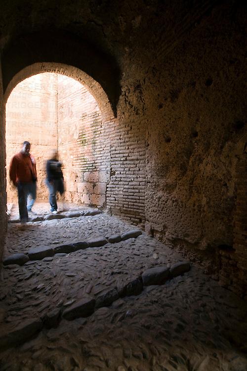 Couple of visitors inside Alcazaba, Alhambra, Granada, Spain