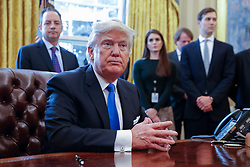 US President Donald Trump (F), with White House chief of staff Reince Pribus (L), White House Communications Director Hope Hicks (2L) and Senior Advisor Jared Kushner (R), after signing five executive orders related to the oil pipeline industry in the oval office of the White House in Washington, DC, USA, 24 January 2017. President Trump has a full day of meetings including one with Senate Majority Leader Mitch McConnell and another with the full Senate leadership. Hope Hicks, one of President Trump's longest-serving advisers, is to step down as White House communications director. The 29-year-old former model has been by Mr Trump's side for years.The news came a day after she testified in front of the House Intelligence Committee, but White House sources said this was not the reason. Photo by Pool/ABACAPRESS.COM