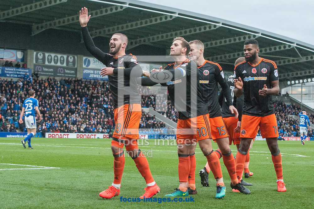 Kieron Freeman of Sheffield United (left) celebrates after scoring his sides first goal during the Sky Bet League 1 match at the b2net stadium, Chesterfield<br /> Picture by Matt Wilkinson/Focus Images Ltd 07814 960751<br /> 13/11/2016